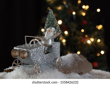 Silver Santa riding a silver vehicle