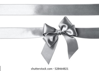 Silver shine ribbons and bow isolated on the white background