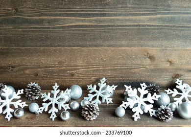 Silver snow flakes ornaments with pine cones.image of Christmas and winter season