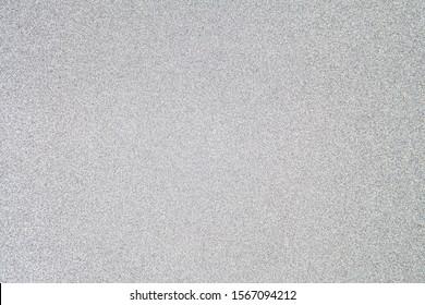 Silberfunkelnd glitzernder abstrakter Hintergrund mit Kopienraum