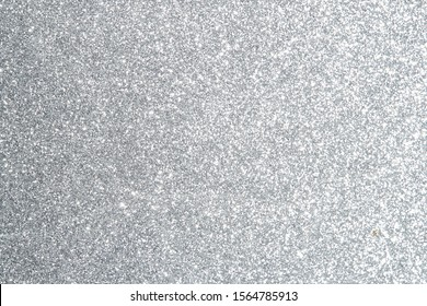 Silver Sparkling Lights Festive background with texture. Abstract Christmas twinkled bright bokeh defocused and Falling stars. Winter Card or invitation	 - Shutterstock ID 1564785913