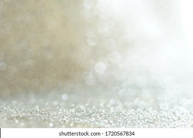 Silver Sparkling Lights Festive background with texture. Abstract Christmas twinkled bright bokeh defocused and Falling stars. Winter Card or invitation