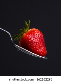 A Silver Spoon Silverware Utensil Holds Fresh Raw Food Red Strawberry Sweet Snack