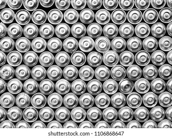 silver spray cans filling the picture