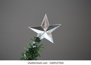 silver star on christmas tree