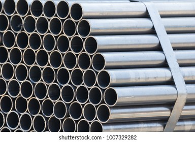 silver steel pipe background and texture, pipe bundle in store yard of factory