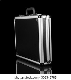 Silver steel suitcase on black background