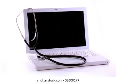 Silver stethoscope over laptop keyboard