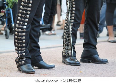 silver studded mariachi pants and tall black boots 9511