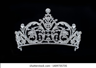 silver tiara with diamonds on black background