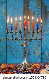 Silver traditional Hanukkah candles all candle lite in the menorah