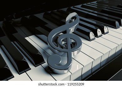 Silver treble clef is on extreme closeup piano keys