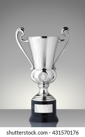 Silver trophy cup on gray background