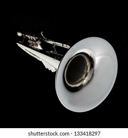 Silver trumpet on  dark background