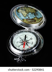 Silver vintage compass, isolated on black