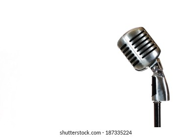 Silver vintage microphone in the studio on white background