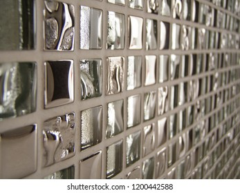 Silver wall tile inside the white temple wall