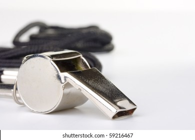 A silver whistle with black string. Add your text to the background.