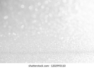 silver and white bokeh lights defocused. christmas abstract background
