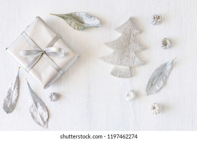 Silver and white Christmas background with traditional elements.