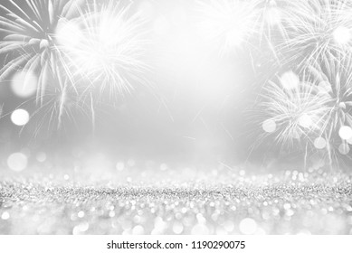 Silver and white Fireworks and bokeh in New Year eve and copy space. Abstract background holiday.
