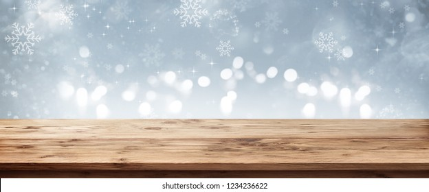 Silver winter background with wooden table for a christmas decoration