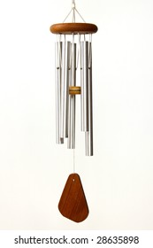 Silver and wood wind chimes on white background