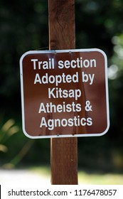 Silverdale, Washington / USA - July 28, 2014: A sign indicating that a section of Silverdale's Clear Creek Trail is sponsored by a group of atheists and agnostics, July 28, 2014.