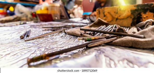 Silvermaker. Silversmiths tools on the silver workplace.