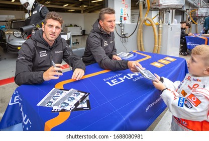 Silverstone Circuit, England. 08/31/2019. Race drivers Riccardo Pera and Christian Ried, Dempsey-Proton Racing. Autograph signing session for the ELMS 4 Hours of Silverstone