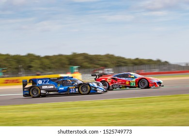Silverstone Circuit, England, 29 Aug - 1 Sept 2019. High Class Racing LMP2 car passing AF Corse Ferrari. WEC 4 Hours of Silverstone