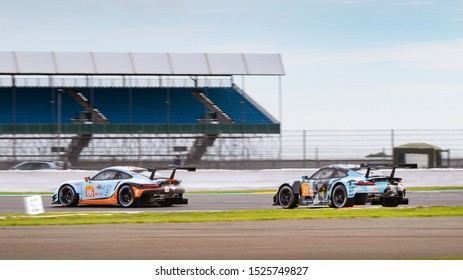 Silverstone Circuit, England, 29 Aug - 1 Sept 2019. Dempsey-Proton Racing Porsche 911 chases Gulf Racing Porsche 911. WEC 4 Hours of Silverstone