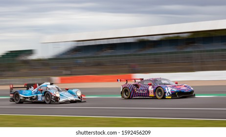 Silverstone Circuit, England, 31 Aug 2019. Cool Racing LMP2 car chases the Ferrari of Kessel Racing, racing at speed. ELMS 4 Hours of Silverstone