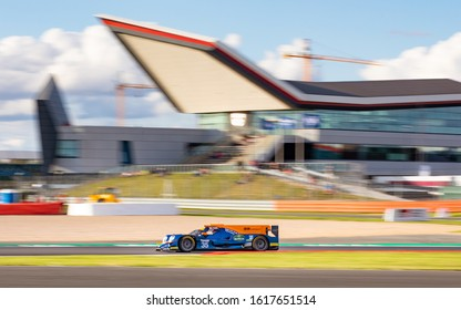 Silverstone Circuit, England, 31 Aug 2019.  BHK Motorsport LMP2 at Club with the Silverstone Wing in the background. ELMS 4 Hours of Silverstone 2019
