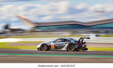 Silverstone Circuit, England, 31 Aug 2019.  Dempsey Proton Porsche heads down Vale with the Silverstone Wing in the background. ELMS 4 Hours of Silverstone 2019