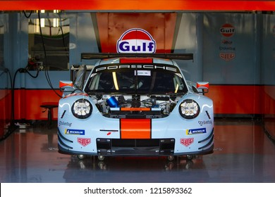 Silverstone Circuit, England. August 17 2018. Gulf Racing Porsche GTE in preparation in the pit lane garage for the WEC 6 Hours of Silverstone.