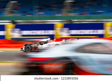 Silverstone Circuit, Northamptonshire, England, August 19 2018, #7 Toyota Hybrid LMP1 with blurred image of car passing in the opposite direction in the foreground. WEC 6 Hours of Silverstone