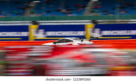Silverstone Circuit, Northamptonshire, England, August 19 2018, BMW M8 GTE with blurred image of car passing in the opposite direction in the foreground. WEC 6 Hours of Silverstone