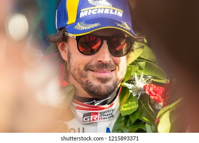 Silverstone Circuit, Northamptonshire, England. August 19 2018. Fernando Alonso wears a garland celebrating victory at the WEC 6 Hours of Silverstone. The car was later disqualified on a technicality.