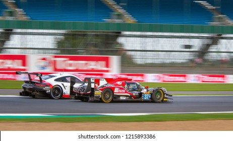 Silverstone Circuit, Northamptonshire, England, August 17 2018. #37 Jackie Chan Racing LMP2 overtakes a Porsche GTE during the WEC 6 Hours of Silverstone