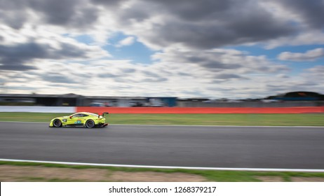 Silverstone Circuit, Northamptonshire, England, August 19 2018. #95 Aston Martin Racing Vantage AMR on Hangar Straight against a large blurred sky. WEC 6 Hours of Silverstone.