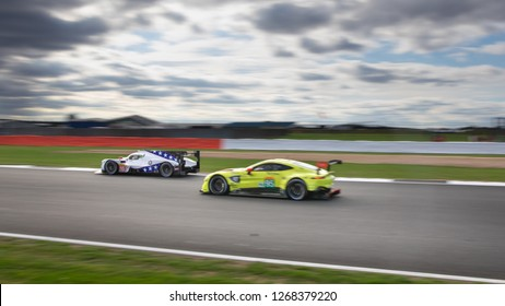 Silverstone Circuit, Northamptonshire, England, August 19 2018. #10 Drangonspeed BR Engineering BR1 Gibson LMP1 passes an Aston Martin Vantage with a blurred sky background. WEC 6 Hours of Silverstone