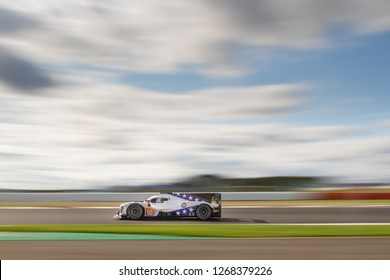 Silverstone Circuit, Northamptonshire, England, August 19 2018. #10 Drangonspeed BR Engineering BR1 Gibson LMP1 speeds along Hangar Straight with blurred big sky background, WEC 6 Hours of Silverstone
