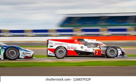 Silverstone Circuit, Northamptonshire, England, August 19 2018. #7 Toyota Gazoo Racing LMP1 Hybrid passes a Ford GT on the Loop at the WEC 6 Hours of Silverstone.