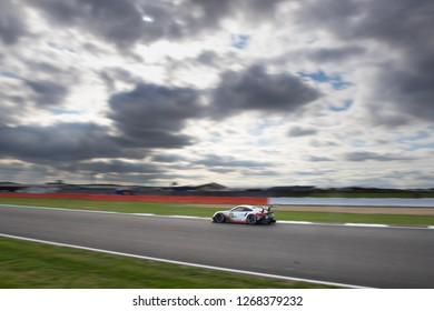 Silverstone Circuit, Northamptonshire, England, August 19 2018. #92 Porsche GT Team Porsche 911RSR GTE on Hangar Straight against large blurred sky, WEC 6 Hours of Silverstone.
