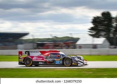 Silverstone Circuit, Northamptonshire, England, August 19 2018. #37 Jackie Chan DC RacingOreca 07 Gibson LMP2 race car heads down the Wellington Straight, WEC 6 Hours of Silverstone.