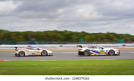 Silverstone Circuit, Northamptonshire, England, August 19 2018. #70 MR Racing Ferrari 488 GTE pursues #81 BMW Team MTEK BMW M8 GTW. WEC 6 Hours of Silverstone.