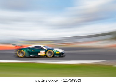 Silverstone Circuit, Northamptonshire, England, August 17 - 18 2018. Spirit of Race Ferrari 488 GTE turns into Abbey at great speed, ELMS 4 Hours of Silverstone. In camera motion blur technique.