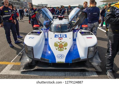 Silverstone Circuit, Northamptonshire, England, August 18 2018. SMP Racing pilot Viktor Shaytar (right of car by door, facing) chats before start of race. ELMS 4 Hours of Silverstone 2018, race grid