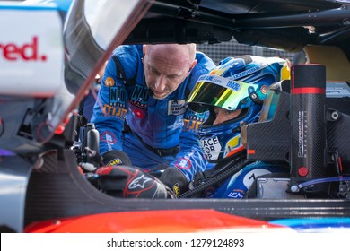 Silverstone Circuit, Northamptonshire, England, August 18 2018. 360 Racing driver Ross Kaiser is helped to settle into his car on the grid at the start of ELMS 4 Hours of Silverstone 2018.
